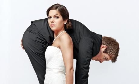 Bride carries her groom.