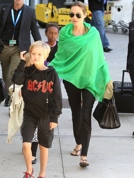 Brad Pitt,  Angelina Jolie  and kids arriving at the Los Angeles International Airport