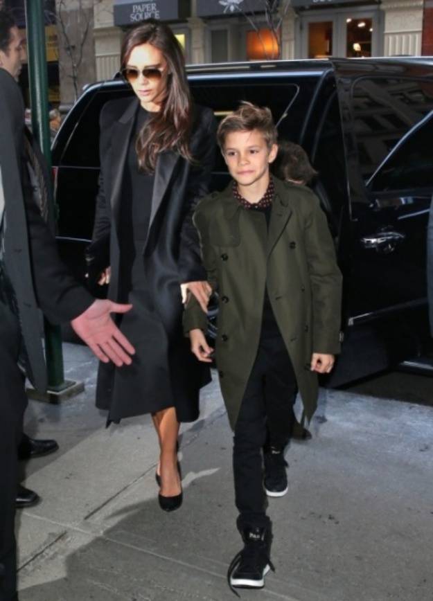 ©NATIONAL PHOTO GROUP David Beckham carries Harper followed by sons Romeo, Brooklyn, Cruz Beckham and wife Victoria out of Balthazar restaurant in NYC. Job: 020914J3 Non-Exclusive Feb. 9th 2014 New York, NY NPG.com