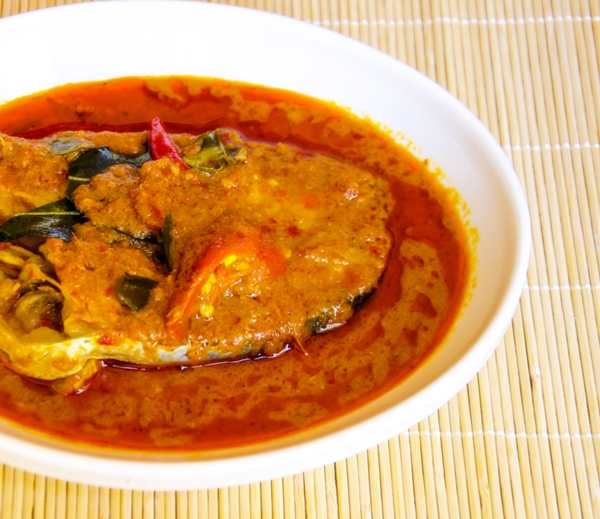 fish curry on bamboo background