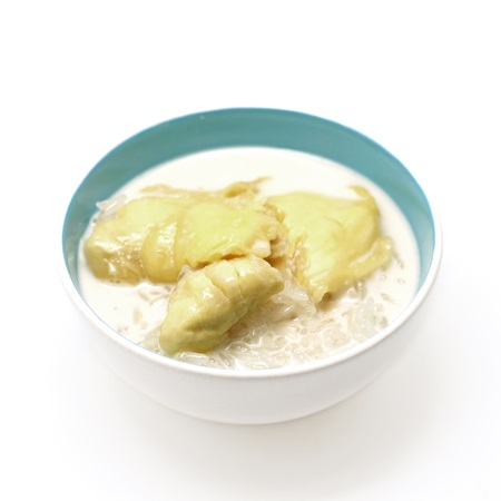 thai dessert, durian sticky rice with coconut milk sauce isolated on white background