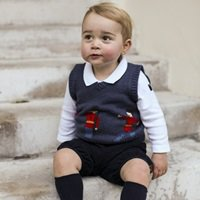 EDITORIAL USE ONLY. NO COMMERCIAL USE  Undated handout photo issued by the Duke and Duchess of Cambridge, taken in late November of one of the three official Christmas images showing Prince George in a courtyard at Kensington Palace, central London.