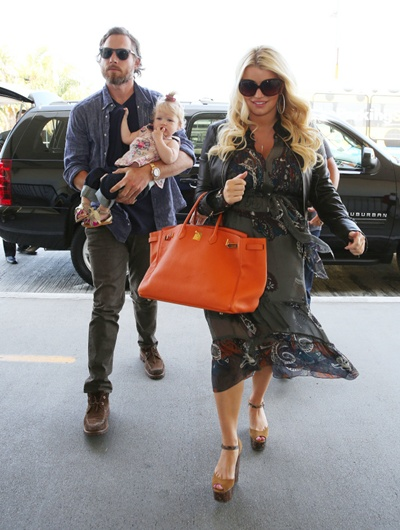 3 May 2013 - LOS ANGELES - USA PREGNANT JESSICA SIMPSON AND HER BOYFRIEND ERIC JOHNSON DEPARTS FROM LAX WITH THERE DAUGHTER MAXWELL DREW JOHNSON BYLINE MUST READ : RIOS / XPOSUREPHOTOS.COM ***UK CLIENTS - PICTURES CONTAINING CHILDREN PLEASE PIXELATE FACE PRIOR TO PUBLICATION *** **UK AND USA CLIENTS MUST CALL PRIOR TO TV OR ONLINE USAGE PLEASE TELEPHONE 44 208 370 0291 or 1 310 600 4723