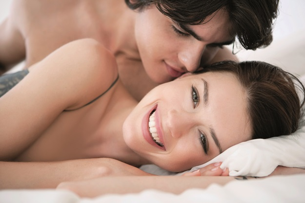 Affectionate couple in bed --- Image by © Felix Wirth/Corbis