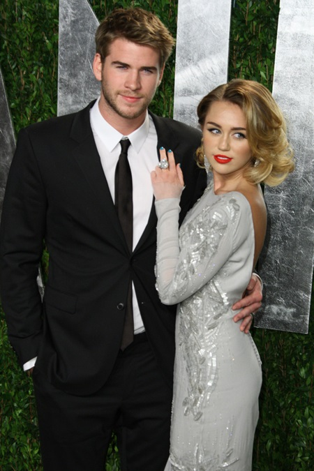 Miley Cyrus, right, and boyfriend Liam Hemsworth arrive at the 2012 Vanity Fair Oscar Party held at the Sunset Tower Hotel in West Hollywood, California on February 26, 2012. (Chaz Niell/Elevation Photos/Abaca Press/MCT) Photo via Newscom