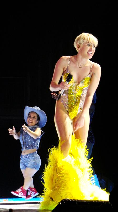 Miley Cyrus opens her Bangerz tour with some dramas as she becomes trapped in costumes and even has her mum Tish on stage to help. Featuring: Miley Cyrus Where: London, United Kingdom When: 06 May 2014 Credit: David Sims/WENN.com