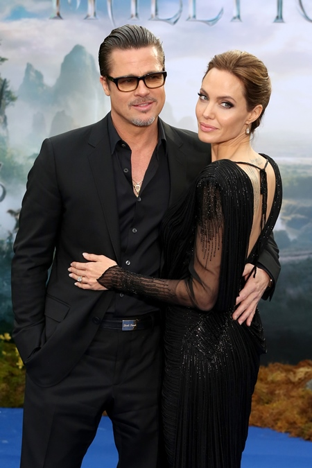 *file photos* Brad Pitt and Angelina Jolie are set to divorceAngelina Jolie has had a double mastectomy to prevent cancer*file photos* Brad Pitt and Angelina Jolie are married according to new reportsMaleficent - private reception event held at Kensington Palace - Arrivals Featuring: Brad Pitt, Angelina Jolie Where: London, United Kingdom When: 08 May 2013 Credit: Lia Toby/WENN.com