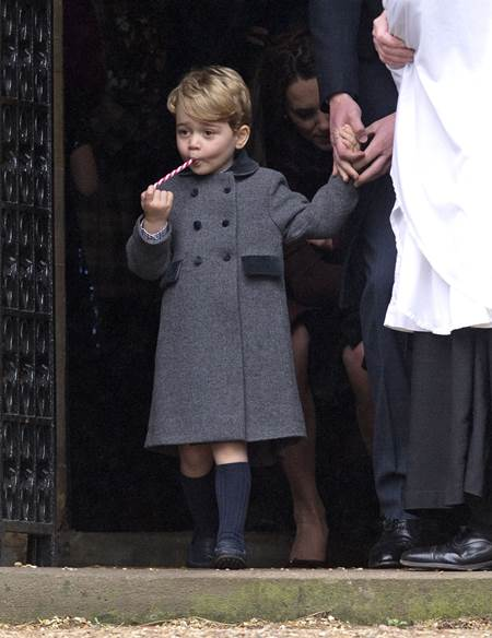 Mandatory Credit: Photo by REX/Shutterstock (7666247g) Prince George after the service with a candy cane sweet Christmas Day church service, Englefield, UK - 25 Dec 2016